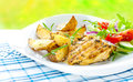 Grilled chicken breast fillet with potatoes and salad baked fresh spring healthy dinner outdoor on white plate Royalty Free Stock Photos
