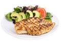 Grilled chicken breast with green salad salad and avocado Royalty Free Stock Photography