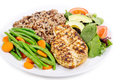 Grilled chicken breast with rice green beans salad and wild Stock Photos