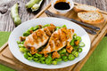 Grilled chicken breast served with fried butter beans and chante Royalty Free Stock Photo