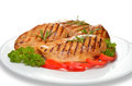 Grilled chicken breast with vegetables on white plate Stock Image