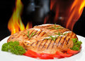 Grilled chicken breast with vegetables on white plate Royalty Free Stock Image