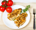 Grilled chicken breasts fillet with fresh vegetables on a white plate Stock Photos