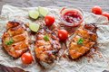Grilled chicken breasts in hot mango sauce with barbecue close up Stock Images
