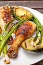 Grilled chicken drumsticks with asparagus and avocado Royalty Free Stock Photo