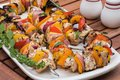 Grilled chicken kabobs on a platter Royalty Free Stock Photo
