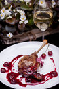 Grilled chicken leg with cherry sauce Royalty Free Stock Photo
