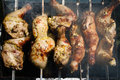 Grilled chicken leg on the grill close up Royalty Free Stock Images
