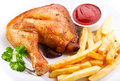 Grilled chicken leg plate of with fries Stock Image