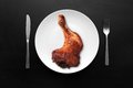 Grilled chicken leg white plate dark wooden table Royalty Free Stock Photos