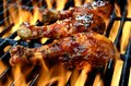 Grilled chicken over open flame barbecued legs Stock Image