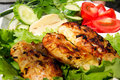 Grilled chicken on salad Stock Photo