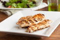 Grilled chicken with salad freshly prepared breasts and ingredients Stock Photography