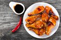 Grilled chicken sticky drumsticks marinated with honey and ginger top view Royalty Free Stock Photography