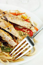 Grilled Chicken on Udon Noodles with Vegetables Stock Photo
