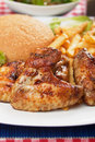 Grilled chicken wings with french fries Stock Photos