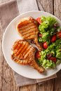 Grilled chop pork honey glaze, served with a salad of fresh vege Royalty Free Stock Photo