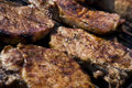 Grilled chops of pork meat on a charcoal grill Royalty Free Stock Image