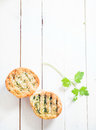 Grilled crusty crisp herb bread on a white wooden table with a sprig of fresh parsley overhead view with copyspace Royalty Free Stock Images