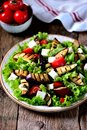 Grilled eggplant salad, tomatoes, feta and lettuce with olive oil and red balsamic, sea salt and pink pepper. Royalty Free Stock Photo