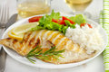 Grilled fish with boiled rice and salad Stock Photo