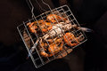 Grilled flower crabs and shrimps on charcoal stove camping at campfire