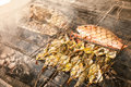 Grilled fresh seafood: prawns, fish, octopus, oysters food background Barbecue / Cooking BBQ seafood on fire Royalty Free Stock Photo