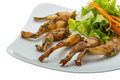 Grilled frog legs french style Royalty Free Stock Photos