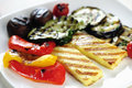Grilled halloumi cheese and vegetables on a plate Royalty Free Stock Photography