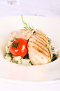 Grilled healthy chicken breast in a plate Royalty Free Stock Image