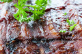 Grilled juicy barbecue pork ribs parsley Stock Photo