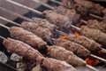 Grilled kofta arabian sticks being cooked on flames Royalty Free Stock Photos