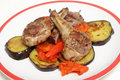 Grilled lamb chops on salsa three a bed of fried aubergine slices and tomato chilli and capsicum Stock Photo