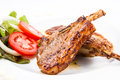 Grilled lamb chops with vegetables on white Royalty Free Stock Photography