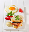 Grilled leberkase sandwich with mustard and fried egg meatloaf Royalty Free Stock Photo