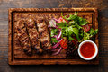 Grilled Lula kebab with salad Royalty Free Stock Photo