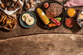 Grilled Meal Spread Out on Rustic Wooden Table Royalty Free Stock Photo
