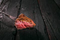 Grilled meat. impale a piece of steak on a fork. Royalty Free Stock Photo