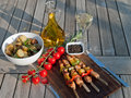 Grilled meat with roasted potatoes dinner served vegetables and rosemary garlic on a wooden plate Royalty Free Stock Images