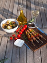 Grilled meat with roasted potatoes dinner served vegetables and rosemary garlic on a wooden plate Stock Photography