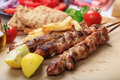 Grilled meat skewers on a table Royalty Free Stock Photo