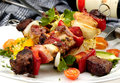 Grilled meat on a spit w vegetable and wine Stock Images