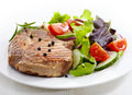 Grilled meat steak and fresh vegetables salad Stock Photo
