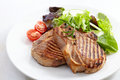 Grilled meat steak and fresh vegetables salad Stock Photos