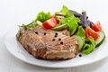 Grilled meat steak and fresh vegetables salad Royalty Free Stock Photography