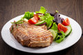 Grilled meat steak and fresh vegetables salad Royalty Free Stock Images