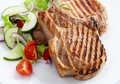Grilled meat steak and fresh vegetables salad Stock Image