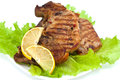 Grilled meat steak with green salad and lemon Royalty Free Stock Photo