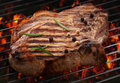 Grilled meat steak on grill Stock Images