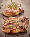 Grilled meat steak on wooden cutting board Stock Photography